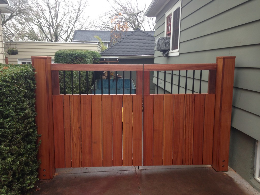 Replaced with Kayu Mas and Red Meranti driveway gates