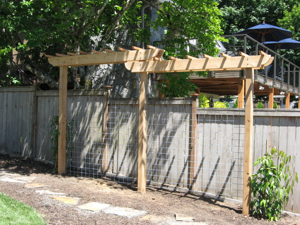 Arbor for existing Clematis (each end) and wire mesh for Raspberries. Cedar - minimum height 8', overall length 13'.